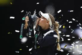 Wozniacki lifting the WTA Finals Trophy in Singapore